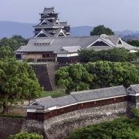Lofty heights: Kumamoto Castle towers majestically above the city of Kumamoto. | ALON ADIKA