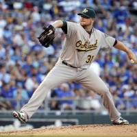 A-OK: Athletics starter Jon Lester pitches against the Royals on Tuesday in Kansas City. Oakland won 11-3.   AP