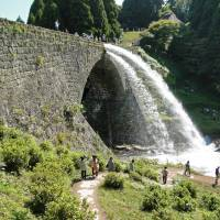 Water pours forth from the Tsujunkyo aqueduct. | MANDY BARTOK
