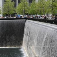Never forget: People crowd around the 9/11 memorial waterfalls in New York in May. | AP