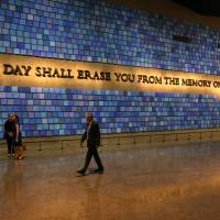 A quote from Virgil is displayed on a wall in the 9/11 memorial museum. | AP