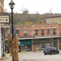 Welcoming environment: High Street in Mineral Point, a mining town in Wisconsin, has been transformed into a charming place of restored old limestone buildings filled with galleries, pottery studios and antique shops. | AP