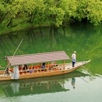 Slow route: Small wooden boats are still used to cross the Nishiki River.   ANGELES MARIN CABELLO