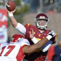 Four TDs in win: Southern Cal QB Cody Kessler throws a pass under pressure from Fresno State's Kyrie Wilson on Saturday. | AP