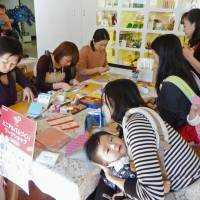 Extra credit: Housewives in Tokyo take part in a course teaching them how to make photo albums.   KYODO