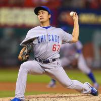 Rough outing: Chicago's Tsuyoshi Wada fires a pitch against St. Louis in the first inning on Saturday night. The Cardinals routed the Cubs 13-2.   KYODO