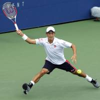 Rolling: Kei Nishikori plays a shot from Argentina's Leonardo Mayer in their third-round match at the U.S. Open on Saturday. | AFP-JIJI