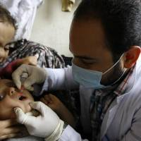 Best defense is a good offense: A Syrian child receives a vaccination against polio at a refugee camp in the southern port city of Sidon, Lebanon, in November 2013. | AP