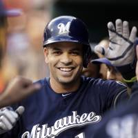 Man of the hour: The Brewers' Aramis Ramirez is congratulated by his teammates after his home run on Friday. | AP