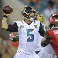 Just getting started: Jaguars rookie Blake Bortles attempts a pass against the Buccaneers during his preseason debut on Friday. | AP
