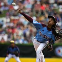 Female pitcher tosses two-hitter