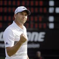Coming up roses: Sergio Garcia pumps his fist after a birdie on the 18th hole during the second round of the Bridgestone Invitational. | AP