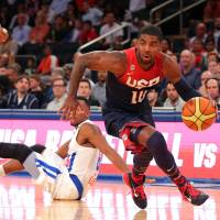 Full flow: United States guard Kyrie Irving drives past Puerto Rico's Alexander Franklin during the Americans' 112-86 win in an exhibition game in New York on Friday. | REUTERS/USA TODAY SPORTS