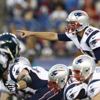 That guy, block that guy: The Patriots' Tom Brady gives instructions at the line of scrimmage on Friday. | REUTERS/USA TODAY SPORTS