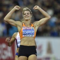 Two for one: Dafne Schippers celebrates her victory in the women's 200 at the European Championships on Friday in Zurich. | AP