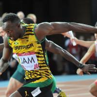Worth the wait: Usain Bolt runs for Jamaica in the men's 4x100 heats on Friday at the Commonwelth Games in Glasgow, Scotland.   AFP-JIJI