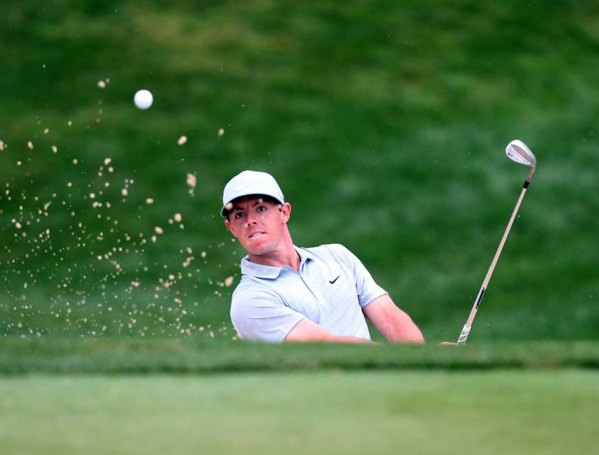McIlroy surges to lead at PGA