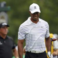Caged: Tiger Woods shot a 74 on Friday to miss the cut. | REUTERS