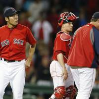 Bad day at the office: Red Sox closer Koji Uehara walks to the dugout after being taken out of Boston's 5-3 loss to the Mariners in the ninth inning on Friday.   AP