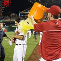 Hit the showers: The Nationals' Anthony Rendon gets a Gatorade shower after his game-winning RBI single in the bottom of the ninth on Wednesday against the Diamondbacks. Washington has won nine straight games. | AP