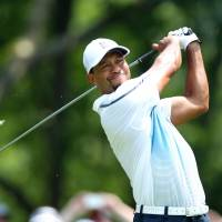 Gutting it out: Tiger Woods, who pulled out of the final round of the Bridgestone Invitational with a back injury on Sunday, will play in this week's PGA Championship starting on Thursday.   REUTERS/USA TODAY SPORTS