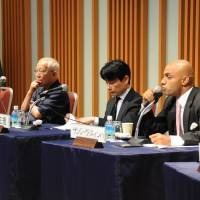 Experts on India answer audience members' questions at a symposium organized by the Keizai Koho Center in Tokyo on June 19. | SATOKO KAWASAKI