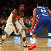 Stars and Stripes: U.S. guard Kyrie Irving dribbles against the Dominican Republic's Juan Coronado on Wednesday. | REUTERS/USA TODAY SPORTS