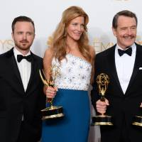 'Breaking Bad' stars Aaron Paul (left), Anna Gunn (center) and Bryan Cranston pose with their acting awards in Los Angeles on Monday. | AP