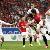 On target: Reds' Ryota Moriwaki (second from right) scores a second-half goal against Ardija in Saitama on Saturday. Urawa defeated Omiya 4-0. | KYODO