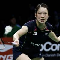 Heat of the moment: Minatsu Mitani returns a shot to China's Li Xuerui during their semifinal match at the World Badminton Championships on Saturday in Copenhagen. Li defeated Mitani 21-8, 21-14. | AP