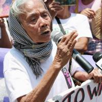 A former 'comfort woman' from the Philippines who was forced to work in a wartime brothel set up by the Imperial Japanese military speaks during a protest Thursday in front of the Japanese Embassy in Manila. | KYODO