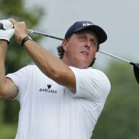 Chasing a title: Phil Mickelson hits off the fifth tee during the third round of the PGA Championship at Valhalla Golf Club on Saturday. Mickelson is three strokes off the pace.  | REUTERS