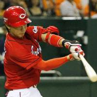 Igniting the offense: The Carp's Shota Dobayashi hits a solo home run in the sixth inning against the Giants at Tokyo Dome on Sunday. Hiroshima defeated Yomiuri 7-2.  | KYODO