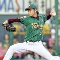 Serious business: The Eagles' Wataru Karashima fires a pitch in Friday's game against the Lions in Sendai. Tohoku Rakuten routed Seibu 7-1.  | KYODO