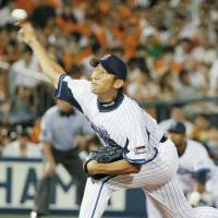 Vintage form: BayStars hurler Daisuke Miura fires a pitch in Thursday's game against the Giants at Yokohama Stadium. Miura went the distance in Yokohama's 10-1 win over Yomiuri. | KYODO