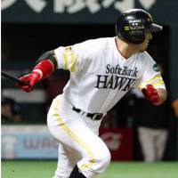 A boost: Nobuhiko Matsunaka hits a go-ahead, pinch-hit double in the fifth inning against the Fighters on Sunday at Yafuoku Dome. Fukuoka Softbank defeated Hokkaido Nippon Ham 6-4. | KYODO