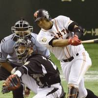 The way it ended: The Giants' Jose Lopez strokes a walk-off single off Tigers closer Oh Seung-hwan in the ninth inning on Tuesday at Tokyo Dome. Yomiuri defeated Hanshin 4-3.  | KYODO