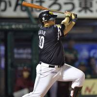 Ending it: The Hawks' Lee Dae-ho delivers the game-winning hit in the 10th inning against the Eagles on Friday in Sendai. Fukuoka Softbank beat Tohoku Rakuten 3-2. |  KYODO