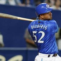 Flying start: Yokohama's Aarom Baldiris hits a two-run home run during the first inning of the BayStars' 8-1 win over the Dragons on Wednesday.   KYODO