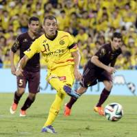 On the mark: Reysol striker Leandro scores on a penalty kick late in the second half against Lanus on Wednesday at Hitachi Stadium. The J. League squad retained its Suruga Bank Championship trophy with a 2-1 victory. | KYODO