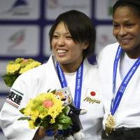 Global recognition: Karen Nun Ira (left) earns a silver medal in the women's under-70 kg division at the World Judo Championships on Friday in Copenhagen.  | KYODO