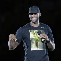 Guess who's back: LeBron James speaks during his homecoming event at InfoCision Stadium in Akron, Ohio on Friday. | AP