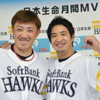 Flying high: The Hawks' Seiichi Uchikawa (left) and Ryota Igarashi pose for pictures during a news conference on Friday. | KYODO