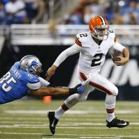 Elusive: Browns quarterback Johnny Manziel breaks the tackle of Lions outside linebacker Kyle Van Noy in the first half of Saturday's preseason game at Ford Field. Detroit beat Cleveland 13-12.  | AP