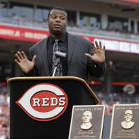 Day to remember: Former Cincinnati Reds player Ken Griffey Jr. speaks on Saturday at Great American Ball Park, a day before his induction into the Reds' Hall of Fame. Reds broadcaster Marty Brennaman (right) look on during Griffey's speech.  | AP