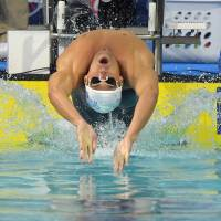 Competition begins: Michael Phelps starts the men's 100-meter backstroke final at U.S. nationals on Saturday in Irvine, California. Phelps finished sixth.  | AP