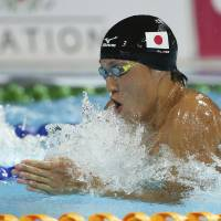 Speed is key: Yasuhiro Koseki competes in the men's 100-meter breaststroke final on Friday at the Pan Pacific Swimming Championships in Gold Coast, Australia. Koseki won the race in 59.62 seconds. | AP