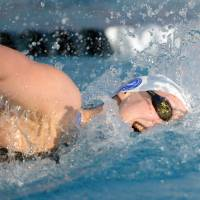Record-setting speed: Katie Ledecky sets a world record time of 3 minutes, 58.86 seconds in the women's 400-meter freestyle at the 2014 USA National Championships in Irvine, California, on Saturday.  | REUTERS/USA TODAY