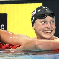 Unstoppable: Katie Ledecky of the United States smiles after setting a new world record in the 1,500-meter freestyle at the Pan Pacific Championships on Sunday in Gold Coast, Australia. | AP