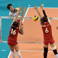 Finding a hole in the defense: Japan's Miyu Nagaoka spikes the ball against China during Friday's FIVB World Grand Prix Finals match at Ariake Colosseum. Japan beat China 25-21, 25-17, 25-21.   | FIVB